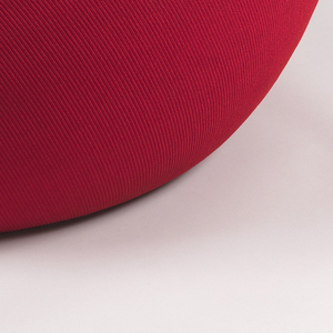 Doughnut-shaped lounge chair of thick foam in red upholstery.