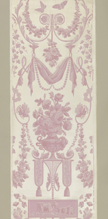 Large-scale arabesque printed in tones of pink, on cream ground sown with gold dots. This paper is printed in panel format, and does not repeat. Sprays of flowers with leaves, a dove, a ram's head, a cluster of fruit, swags of cloth with pearls, and a vase of roses are prominent elements, printed on glazed cream ground with gold polka dots.