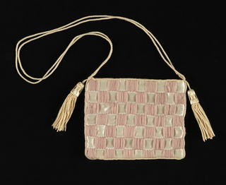 Flat purse, with a checkerboard design formed by stitching down horizontally placed white satin ribbons with vertical groups of pale purple wool yarn. Trimmed with white silk cord and tassels; lined with white cotton.