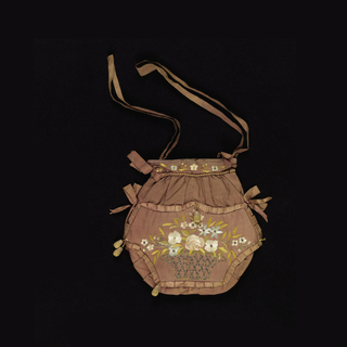 Lady's bag in brown silk, ornamented with embroidery in design of bird perched on an ivy branch on one side and a basket of flowers on the other. Embroidered in polychrome silks with gilt strips, metal-wrapped silk-core threads, gilt coils and spangles. Linen lining.