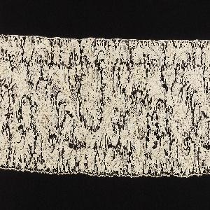 Needlepoint lace border. Elaborate, emerging vine and foliage design.