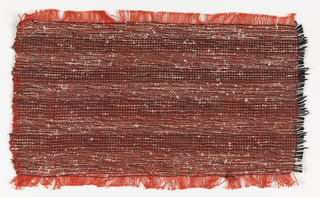 Handwoven sample of a drapery fabric, never produced, in a subtle horizontal stripe.  The warp is of orange-red cotton. The weft in the lighter bands is of black cotton paired with a very uneven white silk yarn. In the darker bands this weft is alternated with a heavy black yarn. The irregularities in the white silk yarn give an all-over effect of a subtly variegated, slubby surface.