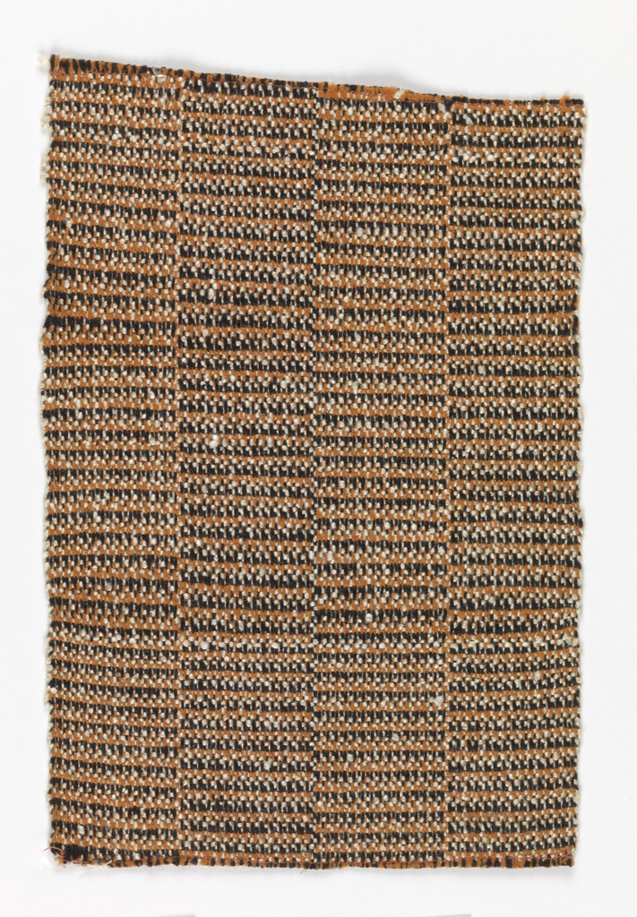 Handwoven sample with vertical bands of tweed textures.  The warp alternates black and orange cotton, the weft is of mercerized cotton bouclé yarn.