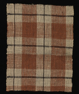 Bold woven plaid in rust and black on a beige ground.