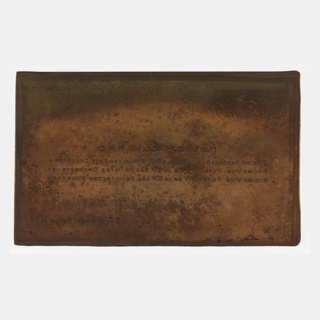 Slightly tarnished copper plate engraved with the name, professional affiliations and address of the French architect, Hector Guimard.  Includes possible original folder and envelope in which the plate was kept.