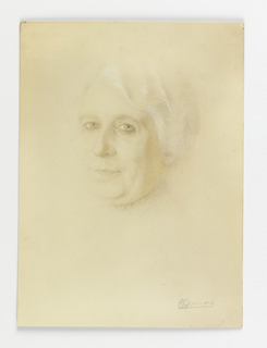 Portrait of woman with white hair and pursed lips.