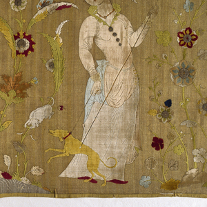 Horizontal rectangular panel with a gold metallic ground and polychrome silk velvet figures of four women separated by large flowering plants. From left to right: a woman holding a long-necked jar in one hand while the other holds up her skirt, in which she has gathered fruits; a woman holding a pitcher in one hand and cradling a large bowl or basin in the other; a woman wearing gloves, holding a bird of prey in her left hand while about to hood the bird with her right; a woman with a long stick with which she is prodding a hound held by a lead in her right hand; the hound is straining the lead. Two of the flowering plants grow at the edge of ponds, one rests on a cloud form and the other grows among the rocks. The iris, carnation, and poppy are recognizable. Clouds and butterflies dot the sky. In shades of blue, green, yellow, reds, and neutral and flesh tones on a gold metallic ground. Slightly more than one unit of the repeat is present; the pattern fills the width of the fabric and is oriented perpendicular to the warp.