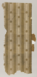 Vertical flock stripes of two widths in lateral repeating pattern. Flock daisy forms in drop-repeating relationship are spaced along the stripes of ground color which are not flocked. Fragments of wood graining wallpaper adhere to one of the long sides. The back is lined with plain paper and mounted on burlap. Greenish-brown flock on beige ground.