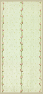 "a) On textured, moire paper, shiny pastel green ground powdered with chartreuse shamrocks. Dominant pattern: three vertical bands of tiny pink roses and green ribbons; b) Crown frieze: continuation of ""a"". Pointed arches formed from the rose bands; green striped fill above. At top edge, horizontal band formed of pink rose buds."
