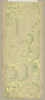 Rococo-revival scrollwork pattern in green and metallic gold on a mica beige ground. Paper support has embossed horizontal ribbing.
