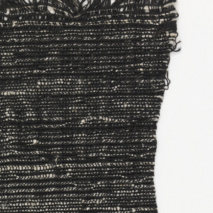Black cotton warp with weft of black cotton paired with hand-spun, slubby white cotton.  The varied thickness of the white yarn and its manipulation in relation to the black yarn in each shed gives the appearance of eccentric weft.