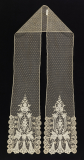 Linen double lappet of bobbin lace on machine net. At either end large-scale floral pattern and cartouche. Rest of net dotted with fleurs volantes.