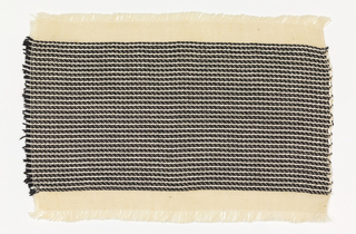 Handwoven sample with a black and white horizontal stripe.  The warp is of off-white cotton; the weft alternates three black yarns with one off-white rayon yarn.  Narrow band top and bottom of plain weave with off-white cotton weft.