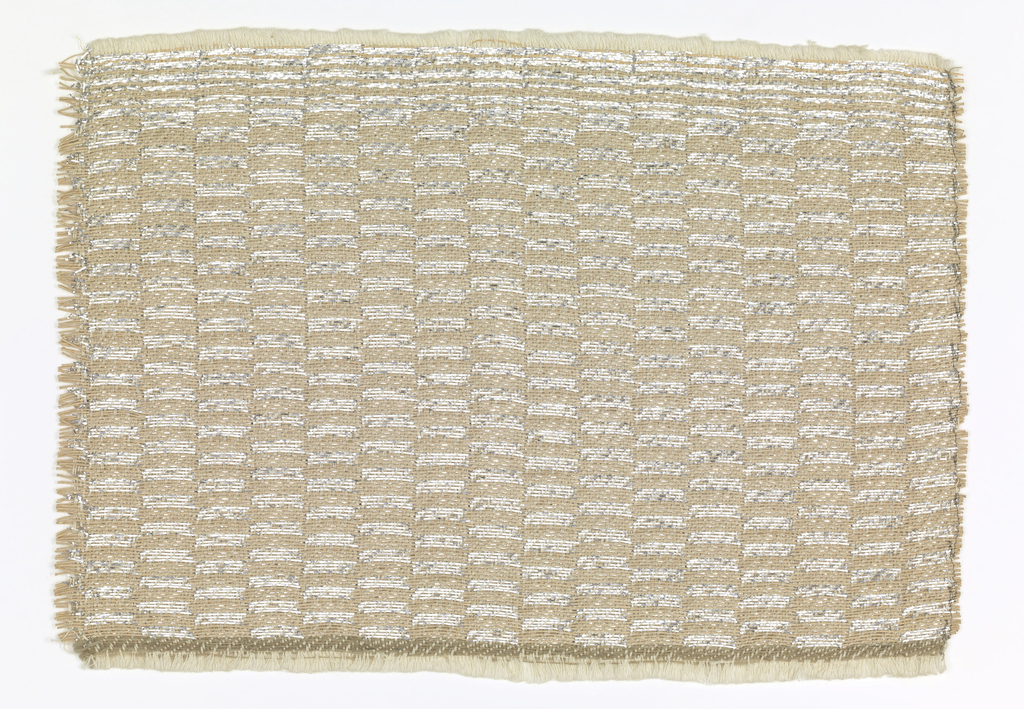 Hand-woven sample in a checkerboard of tan and silver rectangles. The warp is of white cotton, used in pairs. One weft set is aluminum strips and the other tan paper cord.  Each weft appears on the surface in broad weft twill, with the complementary weft similarly bound on the reverse; patterning is created by the interchange of the two weft sets.