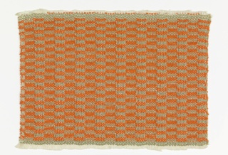 Hand-woven sample for drapery material in a checkerboard of horizontal rectangles of orange and grey-green with an overall vertical stripe effect.  Double cloth type bound in plain weave. The warp is of white cotton used in pairs, bound with single wefts of orange boucle yarn or paired wefts of one gray-green cotton with one gold metallic thread.  The lighter bands are double cloth with a pocketed structure; in the darker bands the two layers are locked together in a taquete structure. The vertical stripe effect is caused by the exchange of wefts from one face to the other.