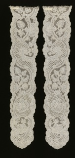 "Cap streamers of Mechlin lace in a design of an asymmetrical ""pearled"" serpentine band, intertwined at intervals by floral and foliated forms."
