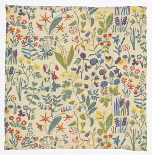Allover pattern of various flowers in muted colors on undyed background. 4 colors or blocks: blue, green, light red, yellow. Over printing of colors for orange, purple, 3 greens.