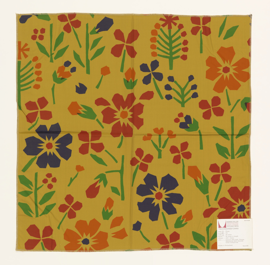 Random placement of stylized flowers, printed in blue, red, orange and green on yellow/ochre.