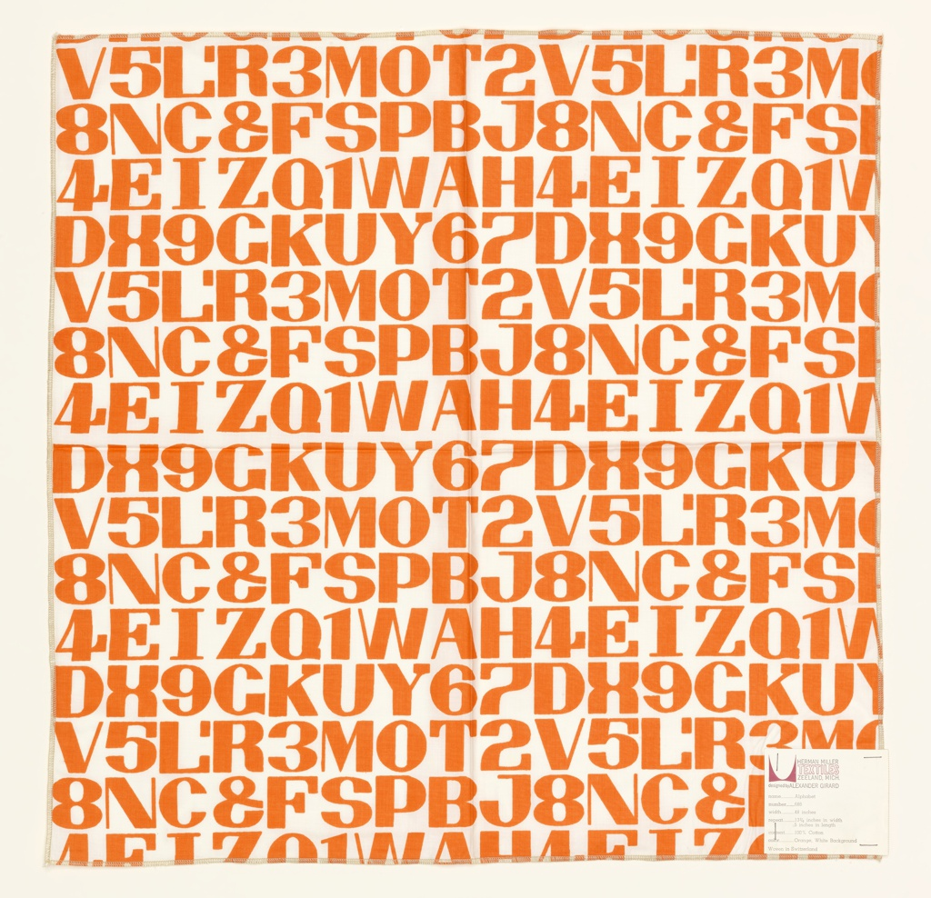 Printed sample with rows of letters and numbers printed in orange on white.
