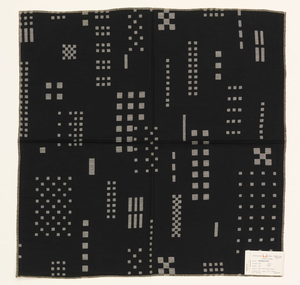 Printed sample with groups of squares and rectangles discharge printed on a black ground, resembling lighted windows in a cityscape at night.