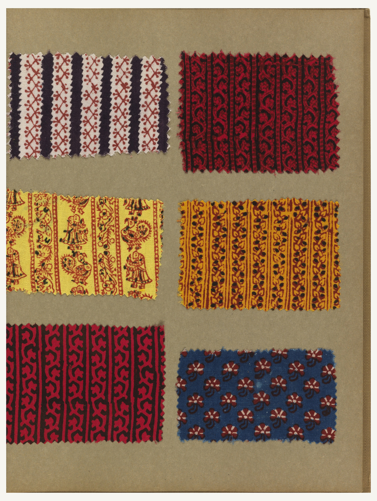 Sample book with textile swatches in a variety of designs and colors including small florals and geometrics, paisley and animals.