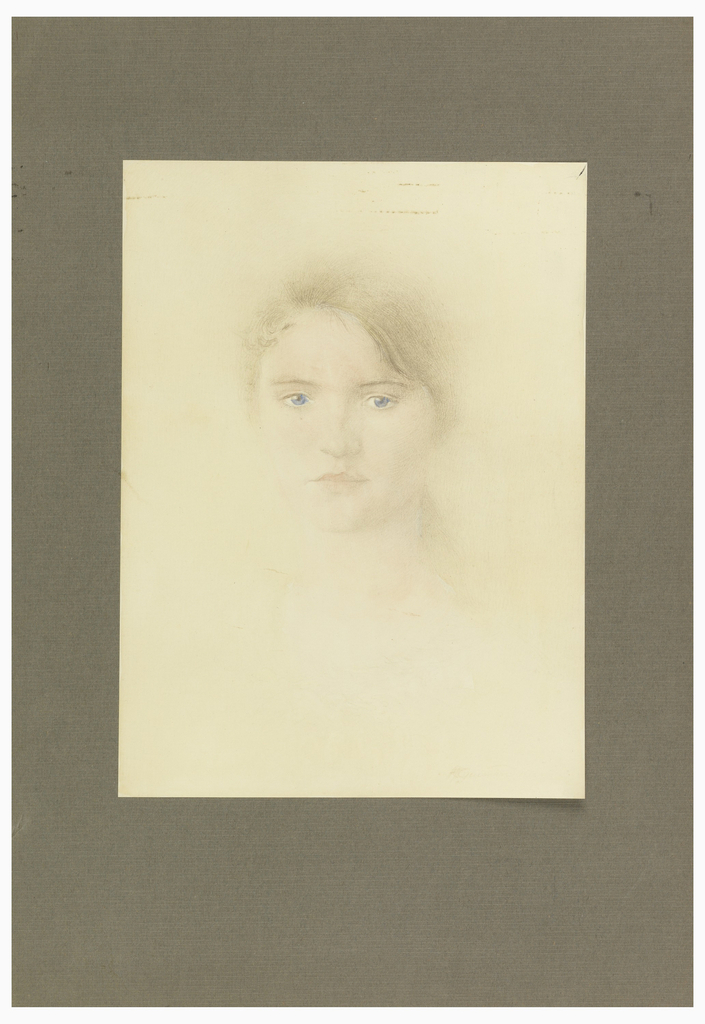 Portrait of woman facing viewer with downcast blue eyes.