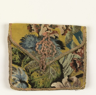 Purse with large floral pattern on a yellow ground. Edges bound with braid and lining is white silk.