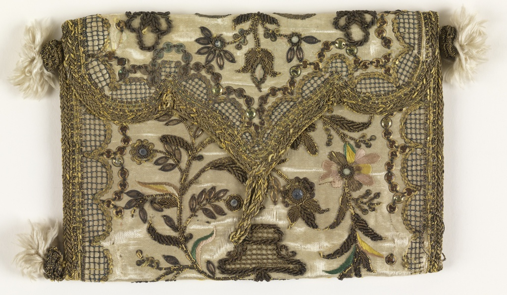Letter case, made as a singel panel and folded, embroidered in silk and metal threads with paste jewels and spangles on a white satin ground, with yellow silk lining and silk tassels at corners (one missing). Embroidered with an urn with a flowering tree, surrounded by swags, bow-knots and an ornamental border.