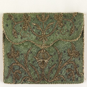 Letter case of green silk damask with conventionalized design in metallic thread;  lining of white silk.