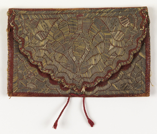 Envelope-shaped case embroidered in stylized floral design in couched metal-wrapped silk on red leather, with word TETUAN and the date 1753. A piece of leather divides the interior into two pockets. Lined with green silk, with a silk cord for closing.