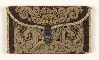 Small flat envelope-shaped case, probably for letters. Dark red silk, basket weave, with woven design in cream color. Back has woven design of a fleur-de-lis on an orb with crown above, and flanked by two lions rampant. Flap, symmetrical foliage decoration. Clasp is lyre-shaped in silver. Blue silk lining. Same pattern on both sides.