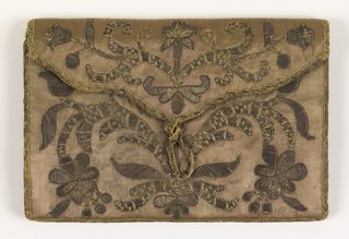 Purse with symmetrical brown floral embroidery on the front and back.  Center back embroidery could be a family emblem.