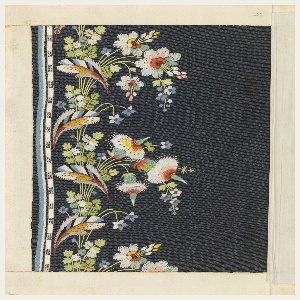 Dark blue ribbed silk embroidered in a border design of small feathers and flowers in multicolored silks.
