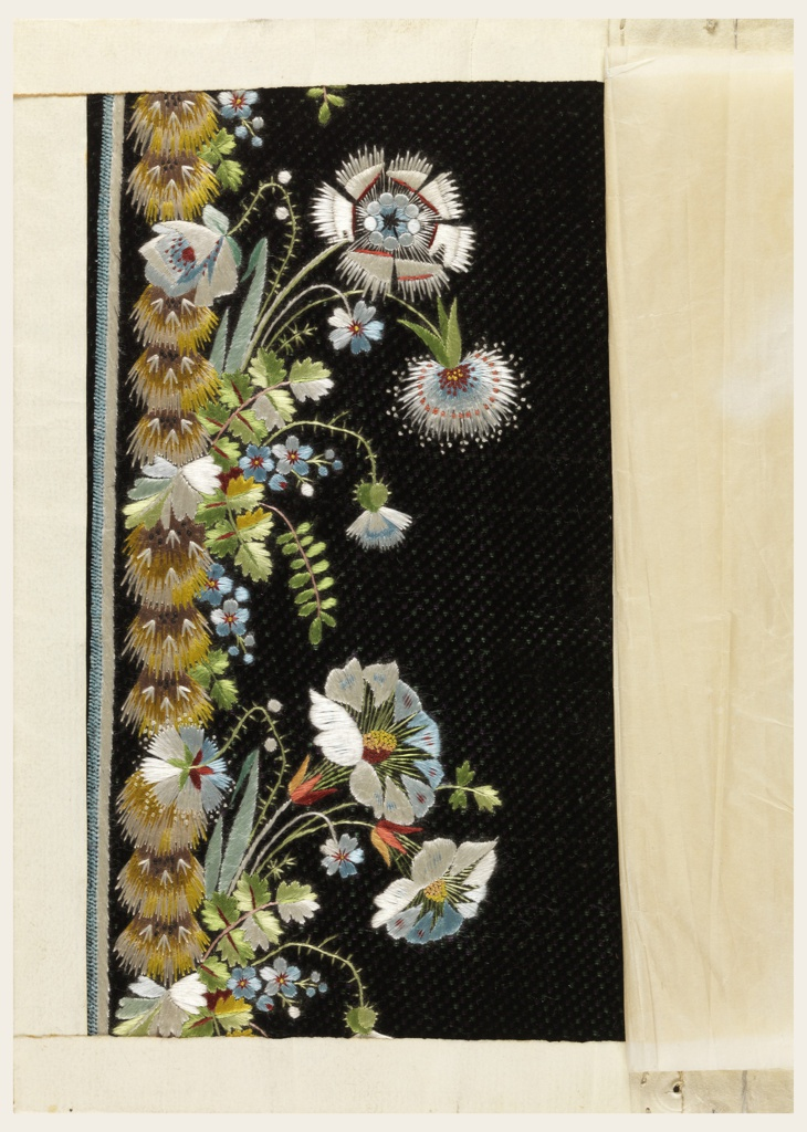Multicolored silk embroidery in a floral design on a black ground.