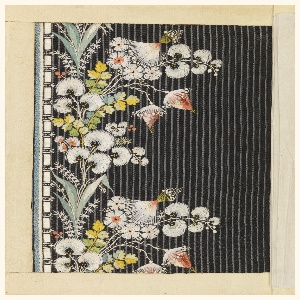 Multicolored silk embroidery in a floral design on a dark blue ribbed ground.