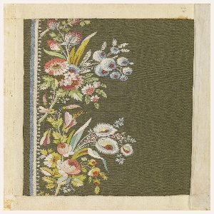 Multicolored silk embroidery in a floral design on a green ground.