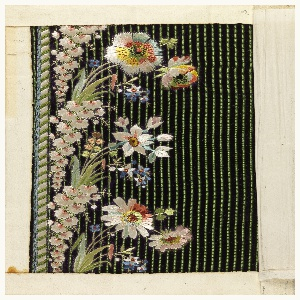 Multicolored silk embroidery in a floral design on a blue ground with green vertical stripes.