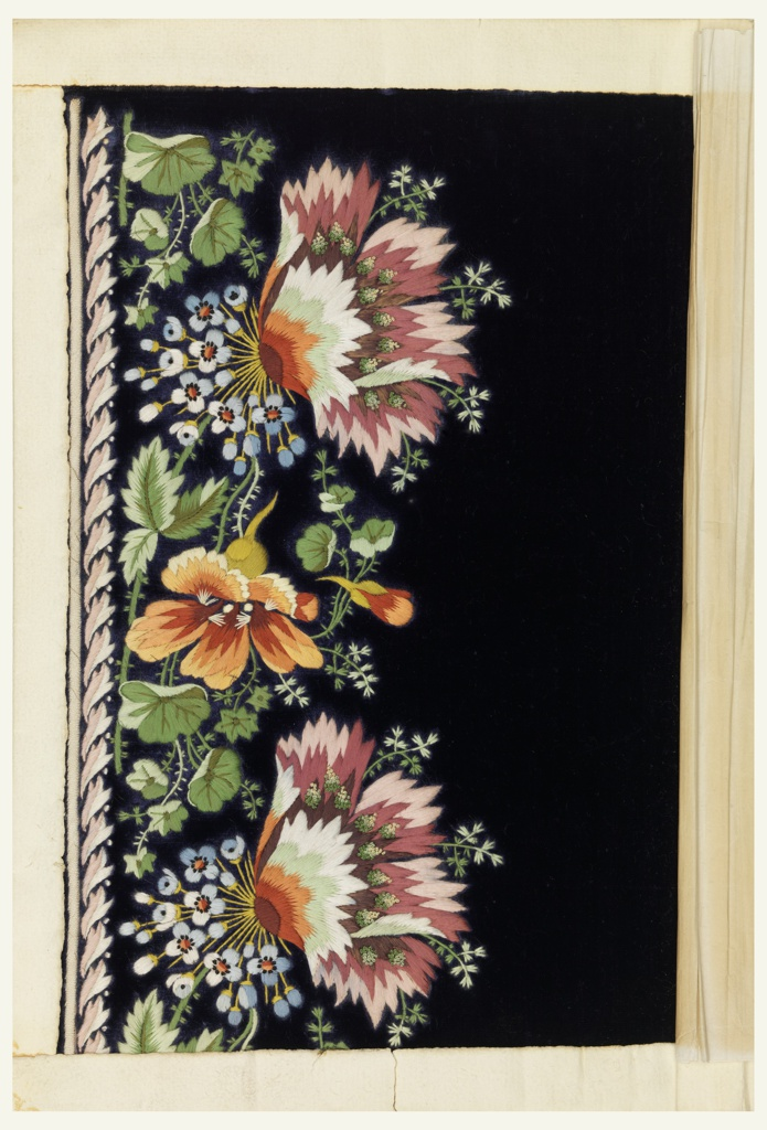 Multicolored silk embroidery in a floral design on a solid blue velvet ground.