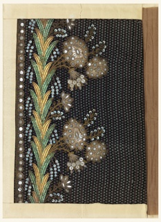 Floral design embroidered with silver and gold wire, gold and green and blue sequins, foil and bits of clear glass on a black and purple ground of small vertical zigzags.