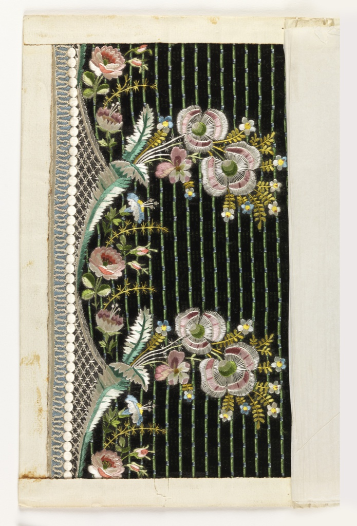 Multicolored embroidery in a floral design on a ground of black velvet with blue and green stripes.