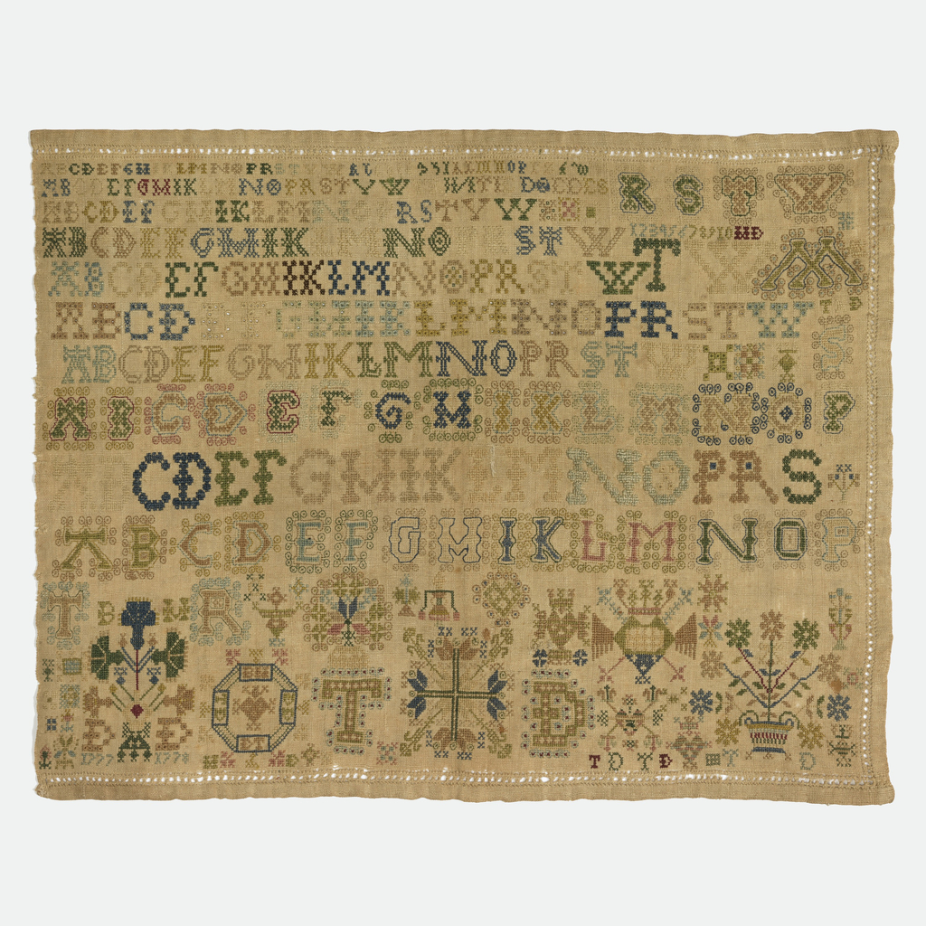 Ten alphabets, some very elaborate and detached motifs. Hemstitching on three sides.