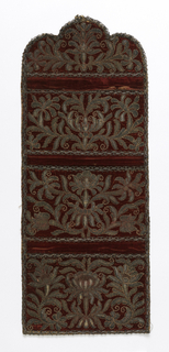 Wall pocket with three pockets, in red silk velvet embroidered in gold and silver threads in heavy symmetrical floral designs. Pockets outlined with narrow silver lace, and whole edged with same.