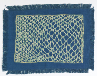 Blue ground embroidered in light blue and white string in a net-like effect. Fringed on four sides.