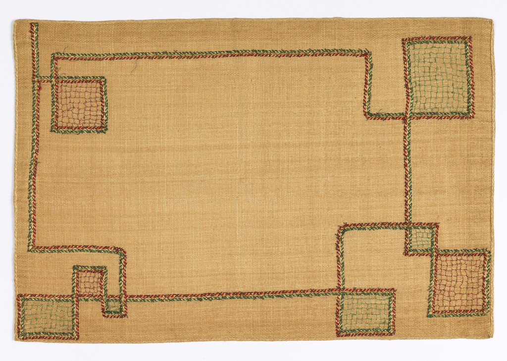 Cream-colored linen with an applique pattern of green, gold and red braid and corner squares worked with metallic thread of green and red. Napkin of natural colored linen with similar corner design in squares.