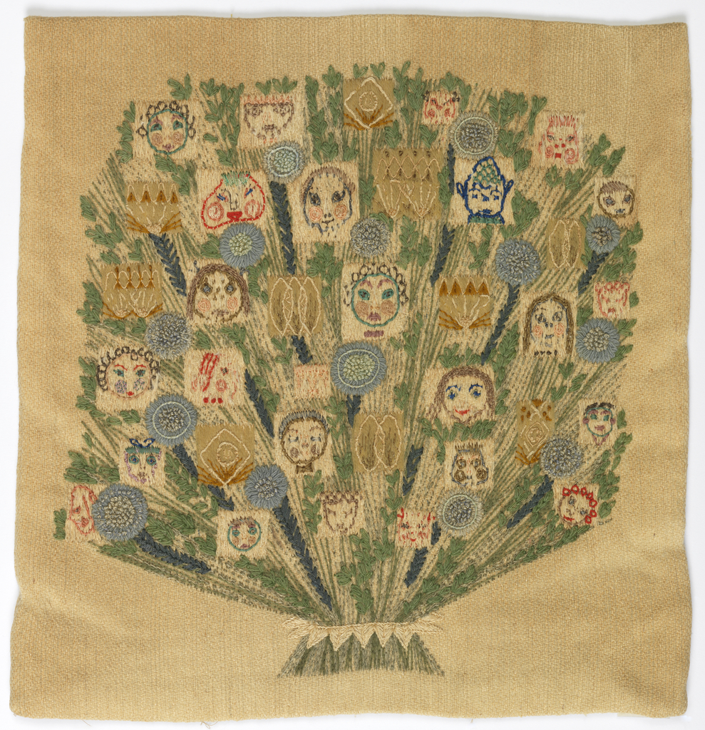 Square pillow cover embroidered on the front with a bouquet of flowers tied tightly at the bottom. Some of the blossoms are human faces. Embroidered in subdued colors on a tan ground.