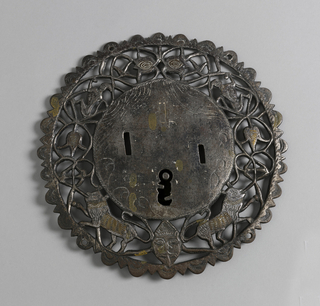 Circular lock and chest, with hasp and key (pair with -135); circular lock-plates with scalloped and serrated outer edge and wide pierced border containing ornamental motifs of devil's head, lions, monkeys and flowers, inlaid with brass; stirrup-shaped hasps with two staples, decorated with incised imbrications and foliate scrolls, each with hinged strap with foliated end; two keys.