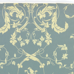 "Against a soft blue ground, a delicate all-over arabesque pattern of leaves, vines and blossoms are printed in one value of pale yellow. Printed in margin: ""1900, The Yarrow, TS & Co."""
