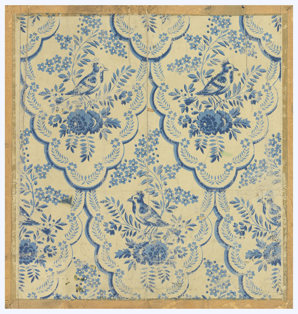 A scalloped fish-scale design. Each frame contains a bird perched on a floral sprig. Design is flipped in alternating horizontal rows. Printed in 2 shades of blue on white ground.
