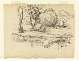 Table top, covered with cloth. Left, statue of a nude torso; center, flowers, fruit and round vase.