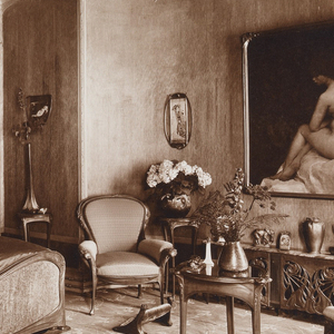 Photograph of Madame Guimard's bedroom in Hector Guimard's house at 22 rue Mozart. Image depicts bed at left, two chairs on right, and image of female nude behind chairs.